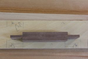 Using the layout stick, you can easily mark the shoulders for a mortise-and-tenon joint.
