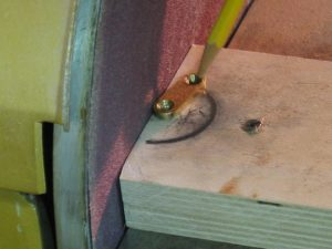 Grind the end clamps on the disc sander.
