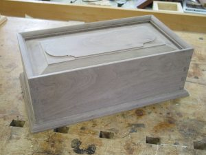 Dovetailed box with mitered, molded top edge.