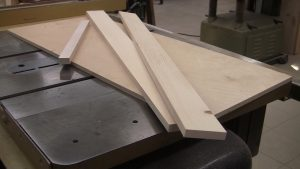 A crosscut sled can be made from scrap material you can easily find around your shop.