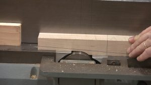 The first step to creating tapered legs on the jointer is to create the pivot point.