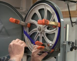 Replacing the tires during your 30-Minute Bandsaw Rehab is easy and doesn't have to get you wet.
