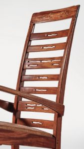 The back of the Greene & Greene Rocker is pierced and carved.
