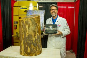 "Scott ""Shuttleman"" Phillips with his Moon Tree log and the plaque from the Kennedy Space Center."