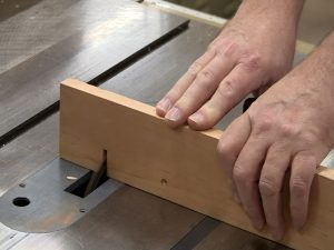 Use a scrap as an auxiliary fence to make the box joint jig.
