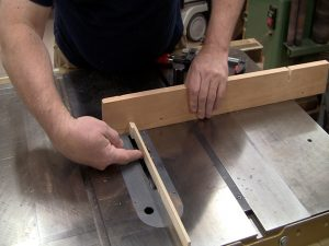 Use the remainder of the strip of material for the pin as a spacer to setup the jig.